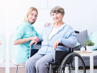 portrait of a smiling caregiver and her old patient