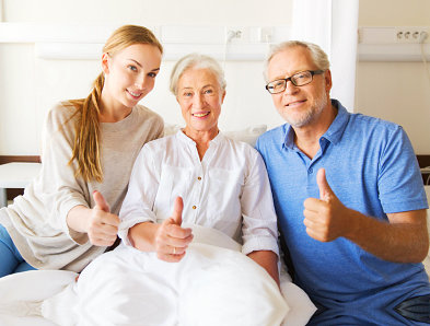 portrait of a happy old couple together with their caregiver
