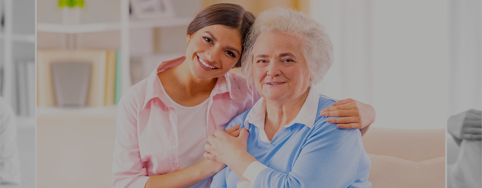 smiling old woman and her caregiver