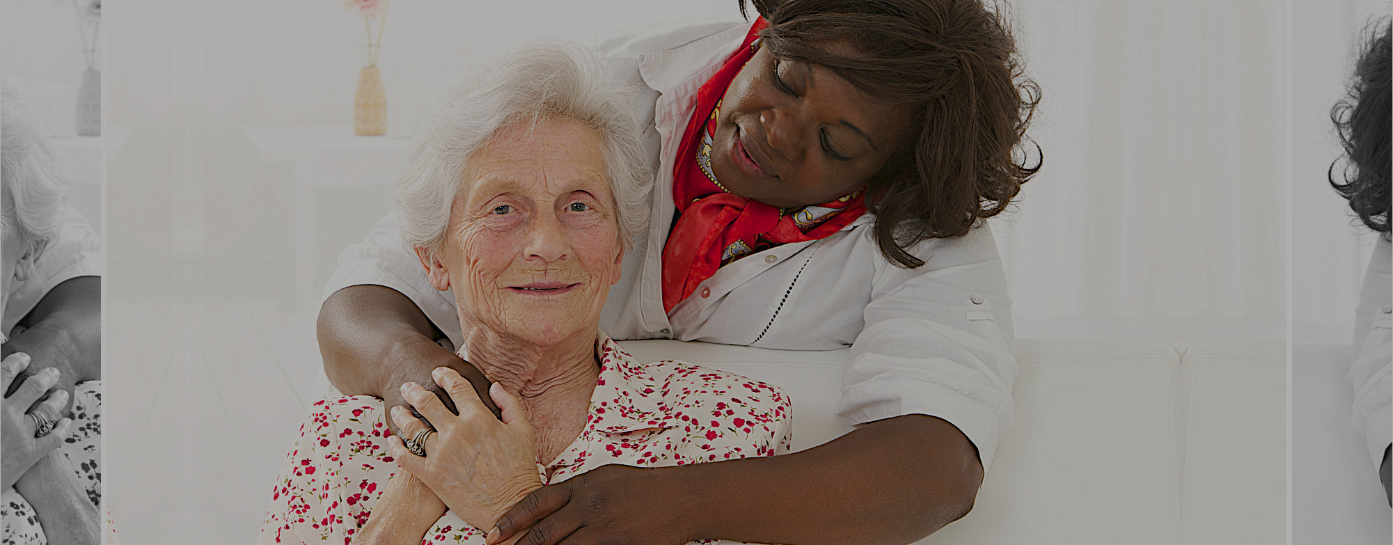 old woman and her caregiver smiling through the camera